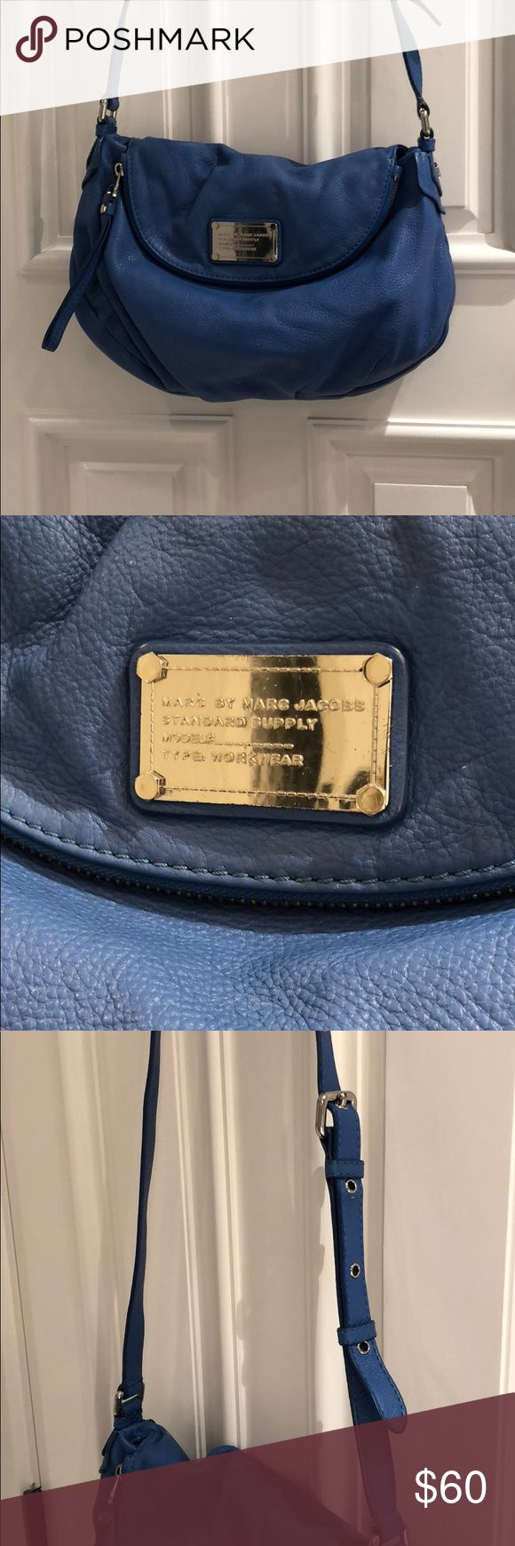 """Marc by Marc Jacobs Large Crossbody Bag Fun blue Marc by Marc Jacobs purse. Gently used. Only sign of use is on the bottom of the bag and at base of strap (see pictures). Some dirt may be able to come off with leather cleaner.   Dimensions: 13"""" across 9"""" deep Marc By Marc Jacobs Bags Crossbody Bags"""