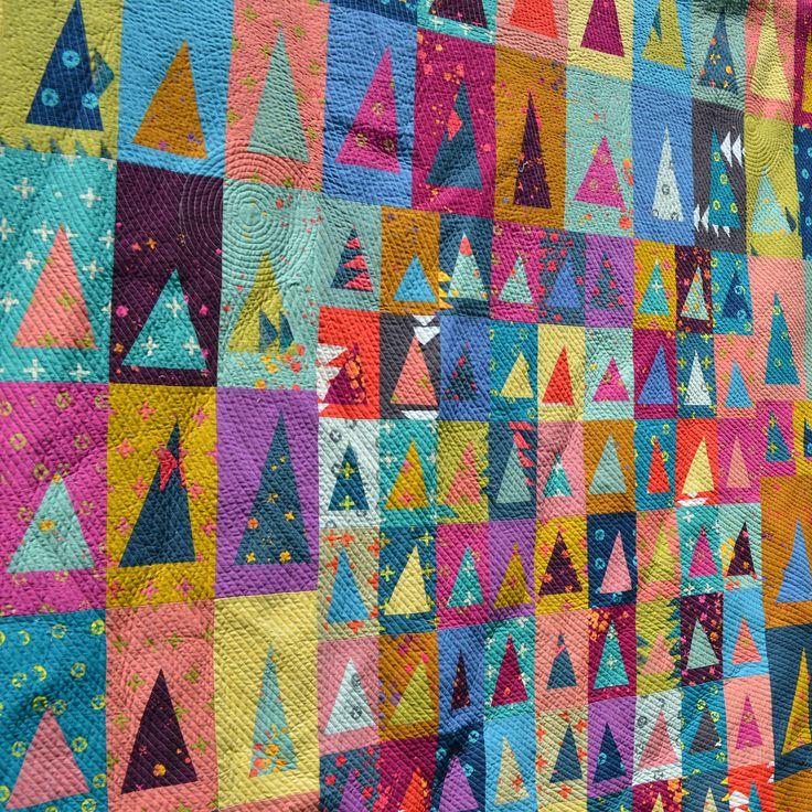 "https://flic.kr/p/shBUSc | Handcrafted Triangles: Quilting | A closeup of the qulting on my Handcrafted Triangles quilt.  See the whole quilt and get all the details <a href=""https://www.flickr.com/photos/jenjohnston/17686255750/"">here</a>"