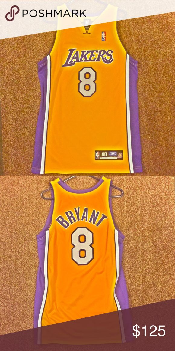 🏆Authentic Kobe Bryant 1998 home jersey🏆 Listed for your consideration is a Kobe Bryant 1998 LA Lakers yellow home Authentic jersey. It is an adult size 40 and There are no rips, holes, tears, or stains. All letters, numbers, and logos have been sewn on. This is an awesome jersey that is sure to make any Kobe fan happy to own! Reebok Shirts Tank Tops