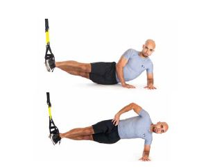 TRX Side Plank Ground Sideways  Places huge demands on total-body stability and deep core muscles  Tips: Contract core and leg muscles to prevent hips from sagging. Perform exercise on hand with arm extended to increase intensity. Perform on both sides.  Adjustment: L  Advanced Strength Exercises | TRX Advanced Suspension Training