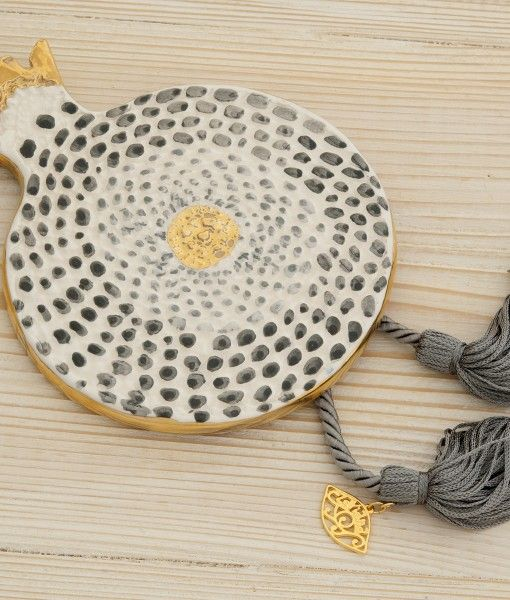 Hand crafted and enamelled pomegranates with gold leaf and tassels.