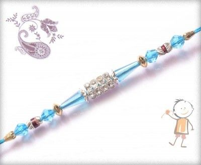 Send trendy and #designer #rakhi for your brother on this #Rakhi #Festival. Send #online Rakhi. Diamond Rings with Blue Crystal Design Rakhi, surprise your loved ones with roli chawal, chocolates and a greeting card as it is also a part of our package and that too without any extra charges.  http://www.bablarakhi.com/send-designer-rakhi-online/791-send-diamond-rings-with-blue-crystal-design-rakhi-online.html