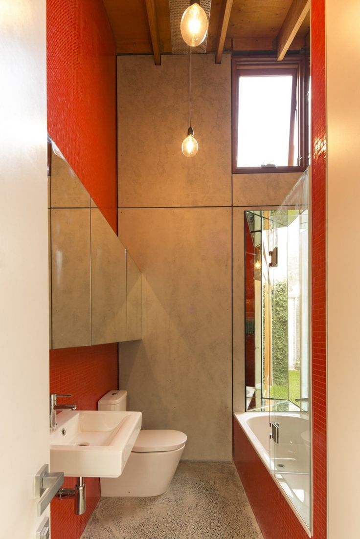 Cool Cowshed House With Open Plan Interiors And Traditional Charm : Cowshed  House With White Red Ceramic Bathroom Walls Closet Wash Basin Mirror Light  Bulb ... Design