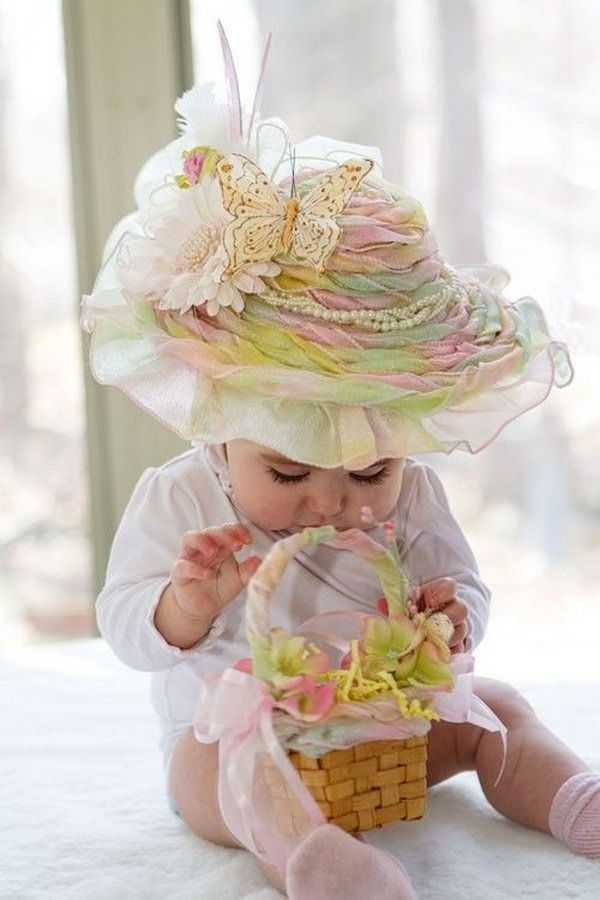 Rainbow Sherbet Frilly Easter Hat. This beautiful large frilly hat has a good combination of colors from the rainbow. With decorations of feathers, ribbon, beaded flower butterfly, it turns a little girl into the princess. http://hative.com/cool-easter-bonnet-or-hat-ideas/