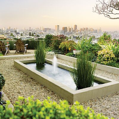 Gravel borders a modern fountain Versatile gravel works beautifully surrounding a modern fountain and echoing the colors of the cityscape beyond. High edging keeps gravel in bounds while giving the impression of a pond within a pond