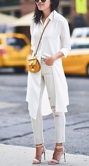 Distressed white skinny jeans and long button-down shirt