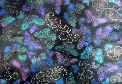 Butterfly background created with Perfect Pearls over black gesso.