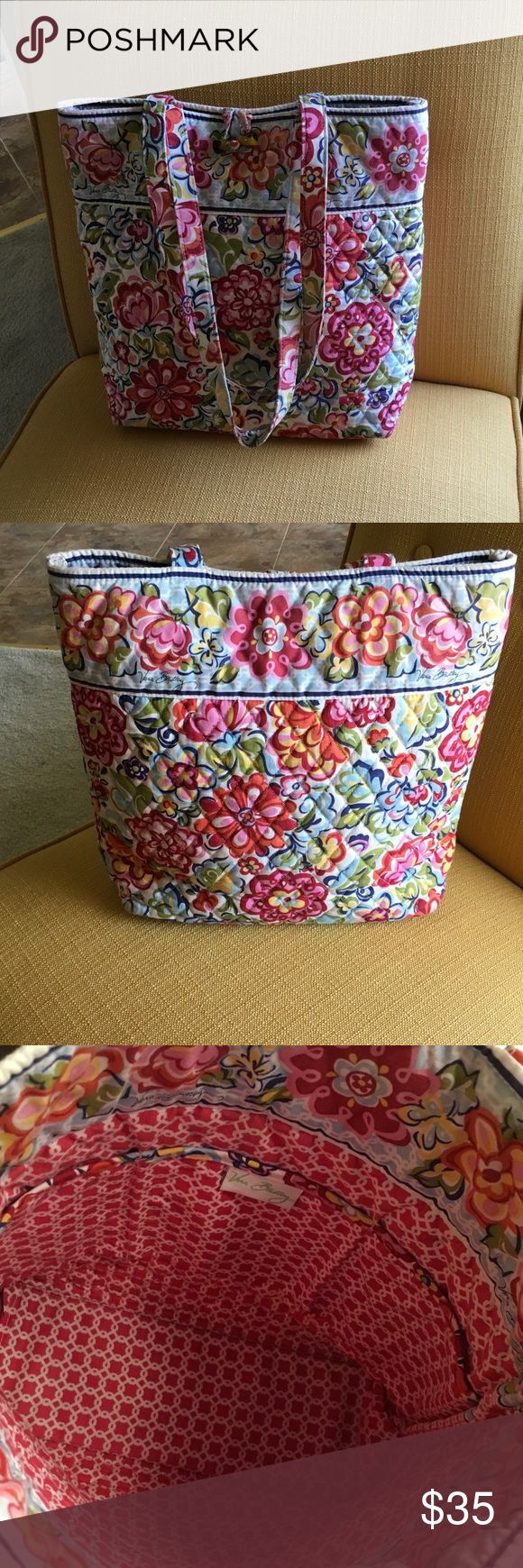 """Pretty Vera Bradley tote bag Lovely colors in this VB tote bag.  Toggle closer.  Three inside pouches.  Red, orange, pink, green, yellow, blue, and cream make up this floral print.  14"""" wide, 13"""" tall, 4"""" depth.  0519SAL Vera Bradley Bags Totes"""