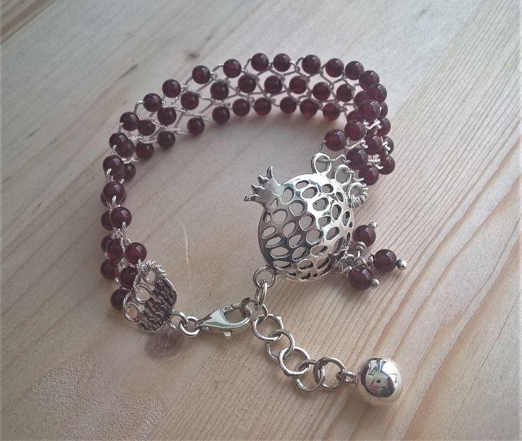 Pure silver mesh bracelet with garnet gemstones and sterling silver pomegranate symbol