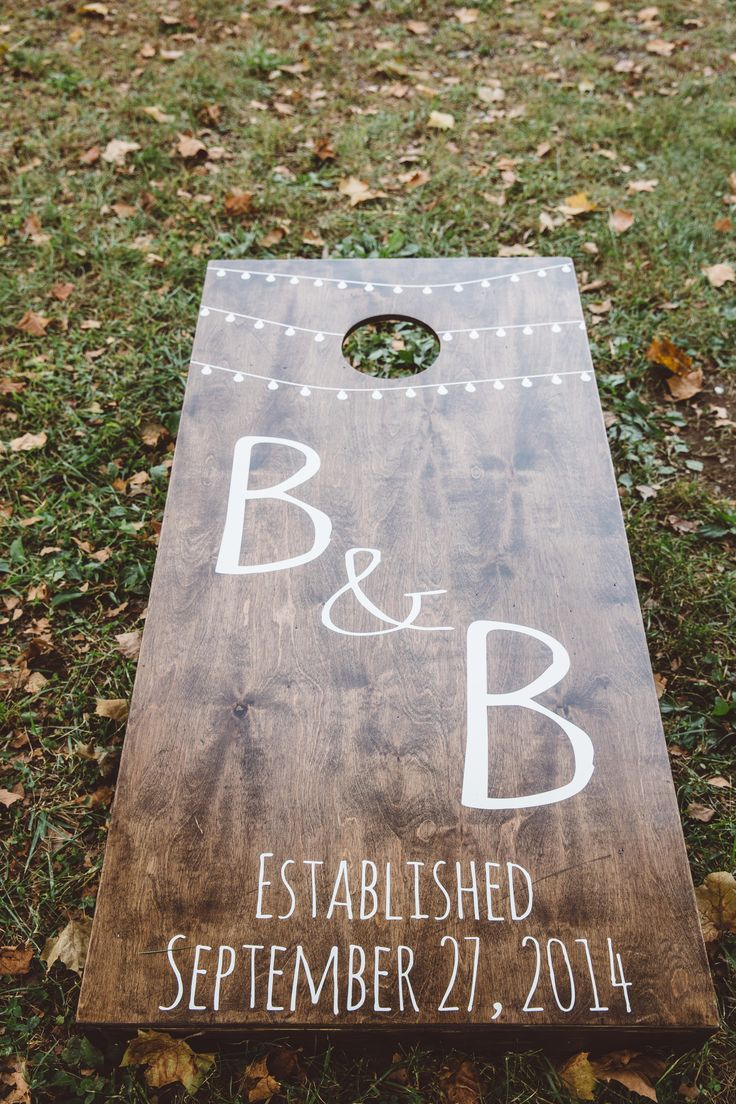 Brittney & Brian on Borrowed & Blue.  Photo Credit: A Muse Photography Custom Wedding Wood Cornhole Boards Rustic Elegant String lights