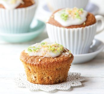 Step 1 Line a muffin tin with muffin cases. Preheat oven to 180°C. Place feijoa flesh in a bowl with lime juice and set to one side. Step 2 Cream spread and sugar together until creamy. Beat in egg yolks. Fold in coconut with remaining dry ingredients. Step 3 Add feijoas and milk. In a separate bowl whisk egg whites until light and fluffy and fold into cake mix. Spoon into muffin cases and bake for 20-25 minutes or until golden brown and firm to touch. Cool completely before icing. Step 4…