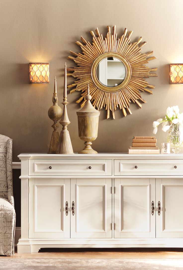 Gorgeous In Gold This Wall Mirror Is A Statement Making Centerpiece On Any Dining Room
