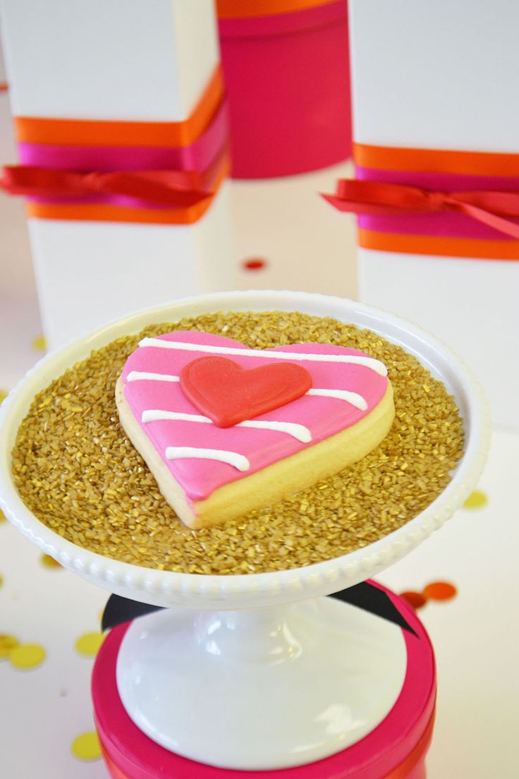 Striped heart Valentine's sugar cookie in pink and red by Bake Sale Toronto.