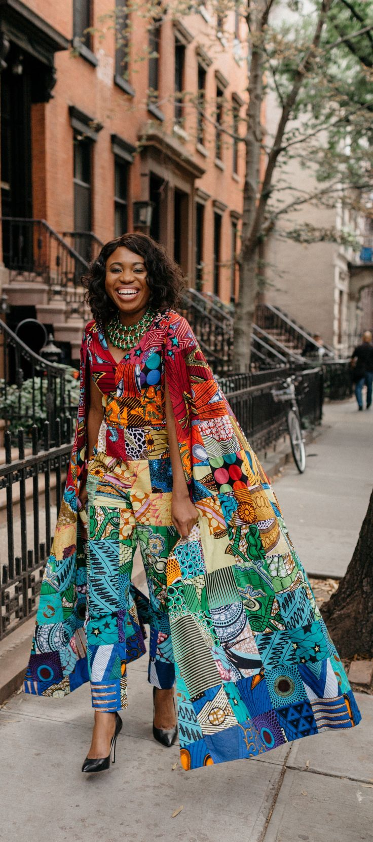 804705bfff552 New African Fashion Tips 8666630886. How I love the dramatic cape sleeves  of this rainbow patchwork ankara jumpsuit. I m sure she turned heads when  she ...