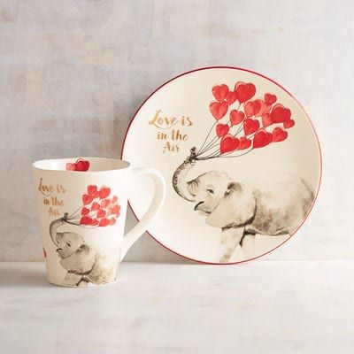 Does it get any cuter than this? With a hand-painted elephant and sentiment, our glazed ceramic plate and mug bring a playful touch to every meal. Love, indeed!