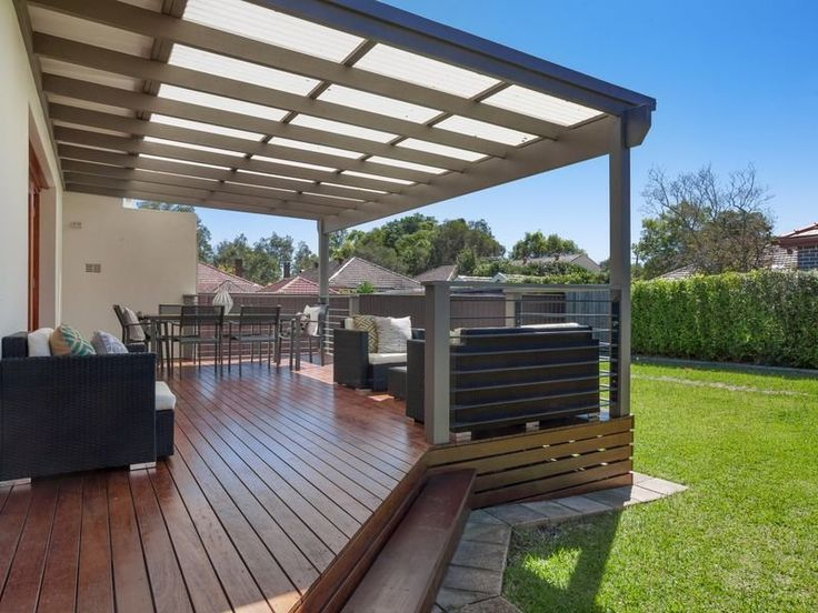 Deck with laserlight roofing above is perfect for entertaining. #deck #roofing