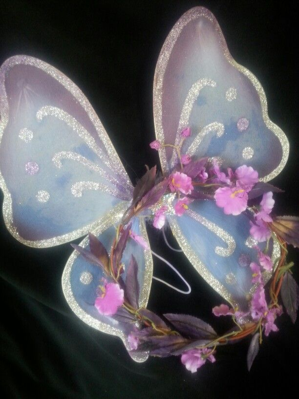 ORCHID -  Fairy unmentioned in Tatania's royal entourage, featured in Shakespeare's Midsummer's Night comedy.  OOAK  childs size wreath of delicate orchid blossoms with handpainted wings to complement.   $25