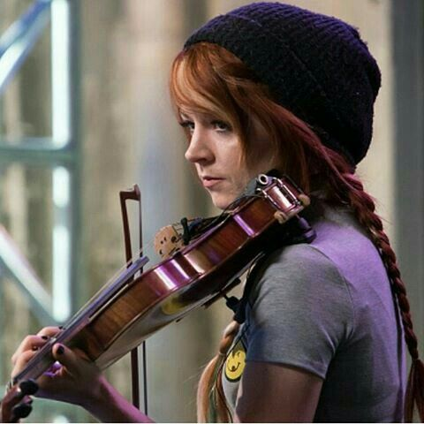 (Open RP) Cassie sat in the rafters of an old warehouse just playing on her Violin. It was the only sound that echoed through the building, till the sharp noise of an opening door made her go silent