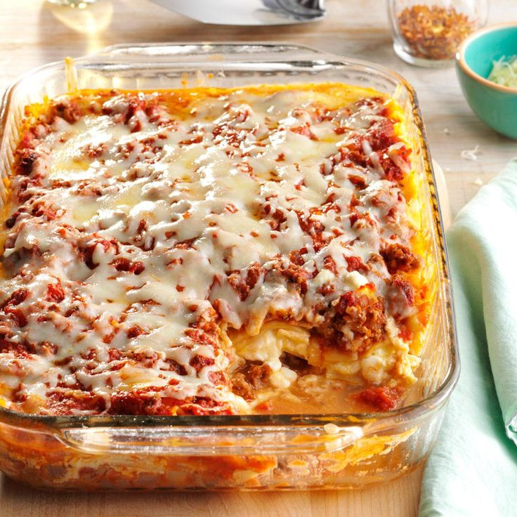 Four-Cheese Lasagna Recipe -Cheese really stars in this lighter lasagna, which I created a few years ago. It can be prepared ahead of time and baked later. I sometimes make up a couple batches and freeze them in case company drops by. —Janet Myers, Napanee, Ontario