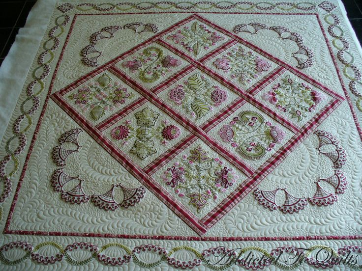 Beautiful quilts ... especially the black and purple floral