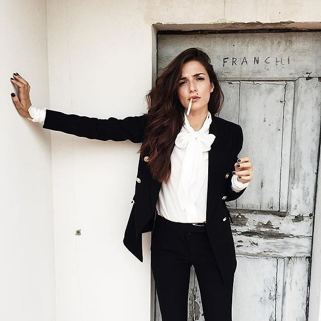A pussy bow blouse under a blazer