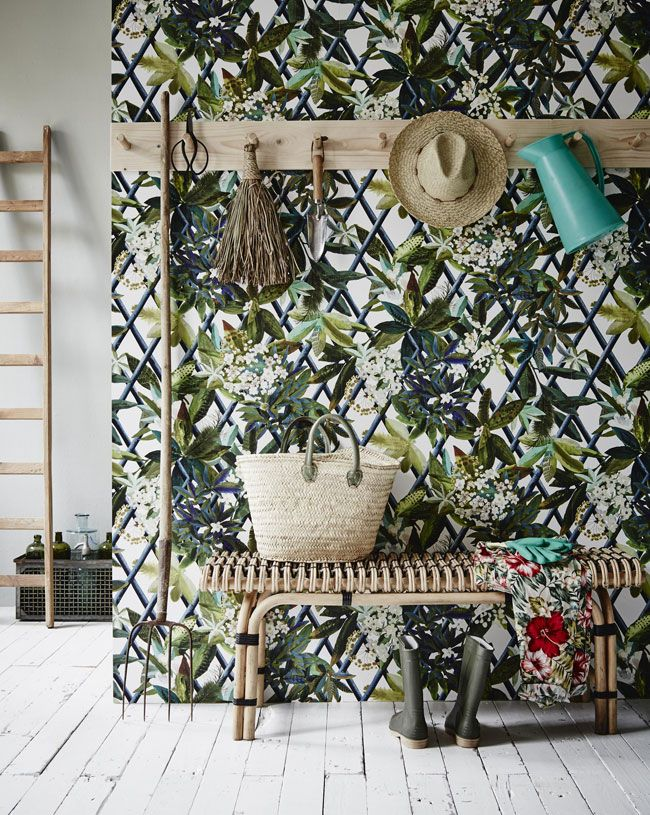 Take inspiration from this beautiful mud room that features a glorious display of plant wallpaper featuring green leaves and flowers that can be used in home design for a splash of green or a botanical accent. Use plants in your home interior design!