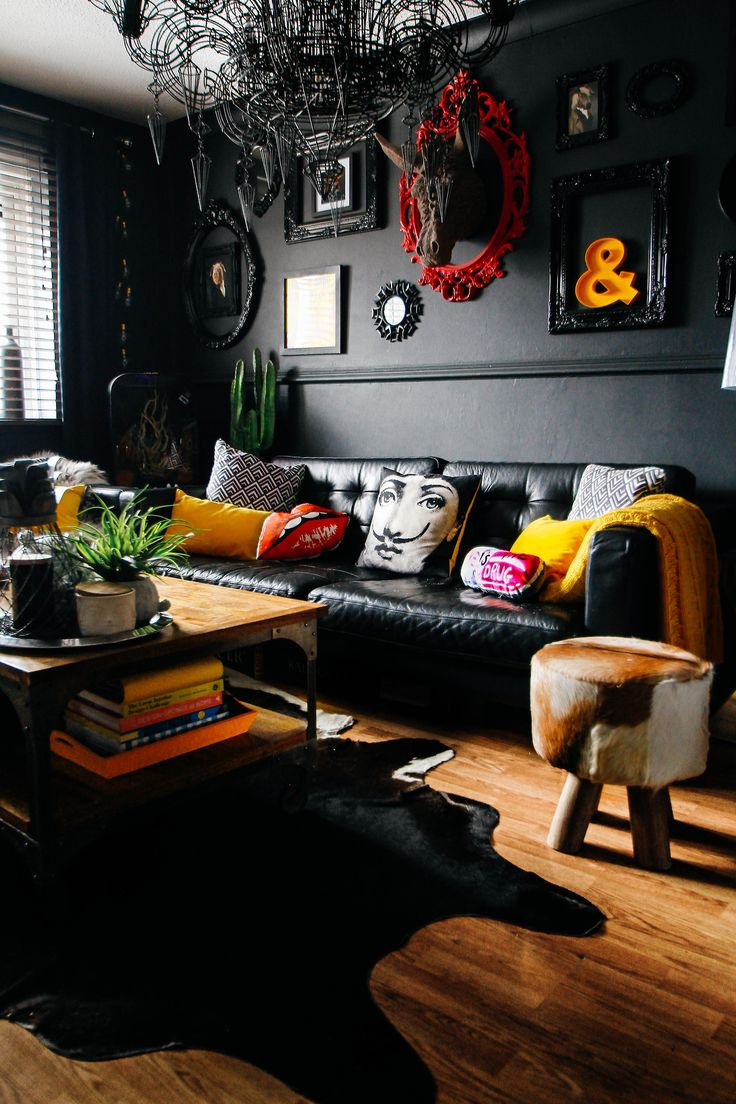 Black living room with yellow accents