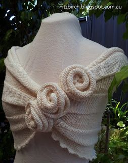 Pretty capelet wrap with knit roses knitting has crochet scalloped edging