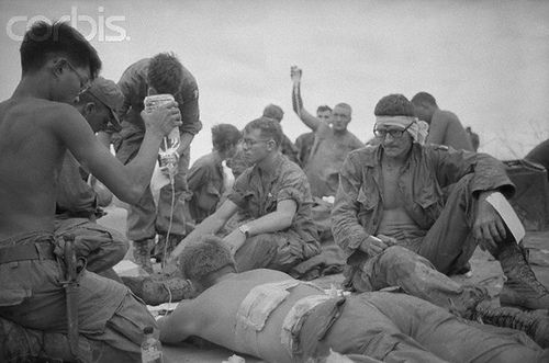 """20 May 1969, Thua Thien Province, South Vietnam --- A Shau Valley, S. Vietnam: Wounded U.S. soldiers receive medical attention as they await evacuation during bitter fighting for """"Hamburger Hill"""" near the A Shau Valley May 12, 1969. U.S. paratroopers captured the summit of the hill May 20, 1969 after 11 assaults in 10 days that killed or wounded more than 300 U.S. soldiers."""