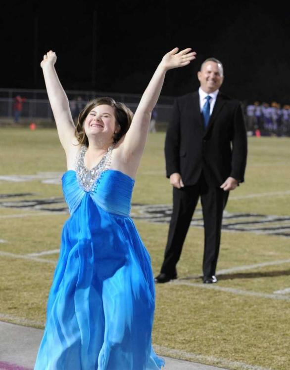 JIM BLAYLOCK/STAFF-Jessica Giddens celebrates being crowned as her father, John Giddens, watches. Jessica has Down syndrome. #DownSyndrome #BeInspired
