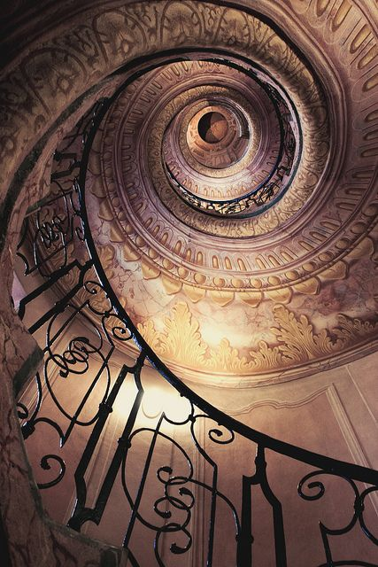 I can't tell if the upper levels on this staircase are real or some sort of optical illusion...very neat!
