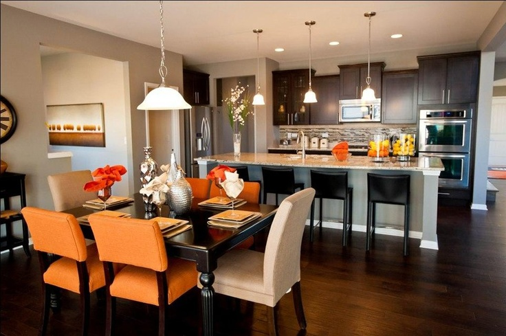 Orange accents are an excellent complement to earth tones for Earth tone kitchen designs