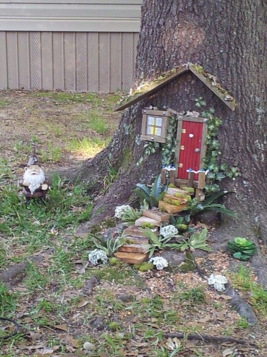 My yard gnome decides to move into th tree in my front yard, so he built him a house in it.