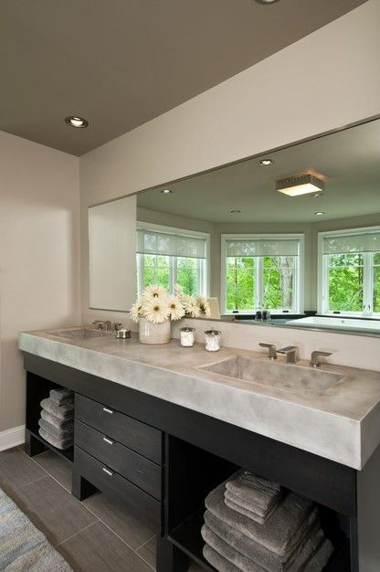 Love the poured concrete countertops and open shelving below.