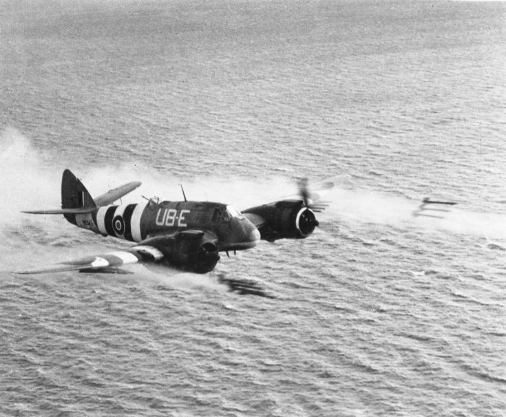 A salvo of eight rocket projectiles being fired over the North Sea by Bristol Beaufighter TF Mark X, NE543 'UB-E', of No. 455 Squadron RAAF based at Langham, Norfolk.