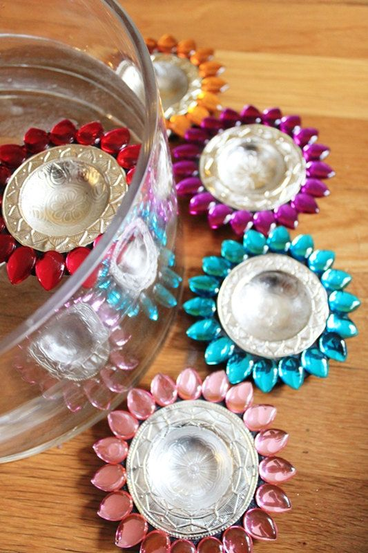 Beautiful Indian 'rangoli' candle holders by Etsy store Nirman. - Maybe for the bridesmaids to carry?