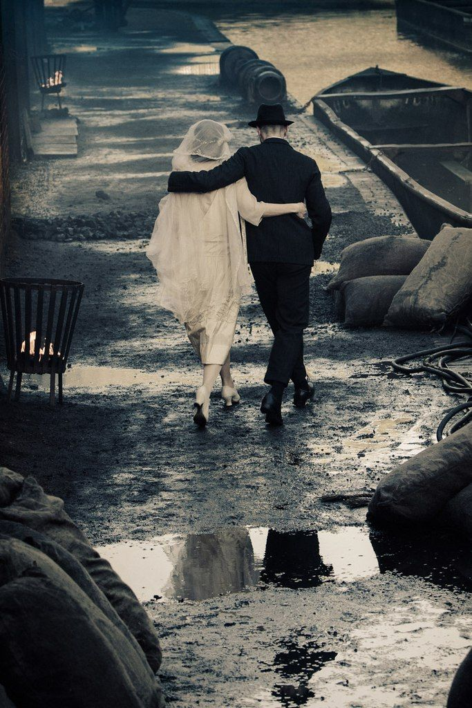 Peaky Blinders - Season 1.  Love the contrast of her white dress against the dirt, sludge, and grime of the street