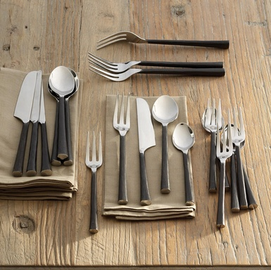 love the flatware's rustic refinement, the polished tines and bowls meeting rough-hewn, blackened handles.