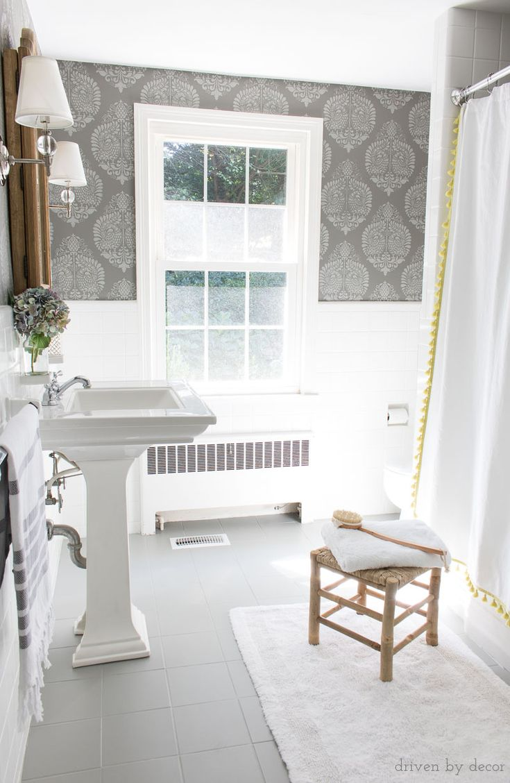 Best 25 painting tile floors ideas on pinterest painting tiles a budget bathroom remodel with ceramic tile floors painted gray and walls stenciled to look like doublecrazyfo Gallery