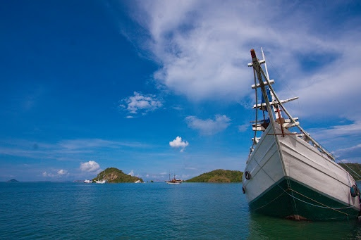 A Traditional Fishing Boat by Adhi Rachdian - A Traditional Fishing Boat at Anchor in Komodo Island Click on the image to enlarge.