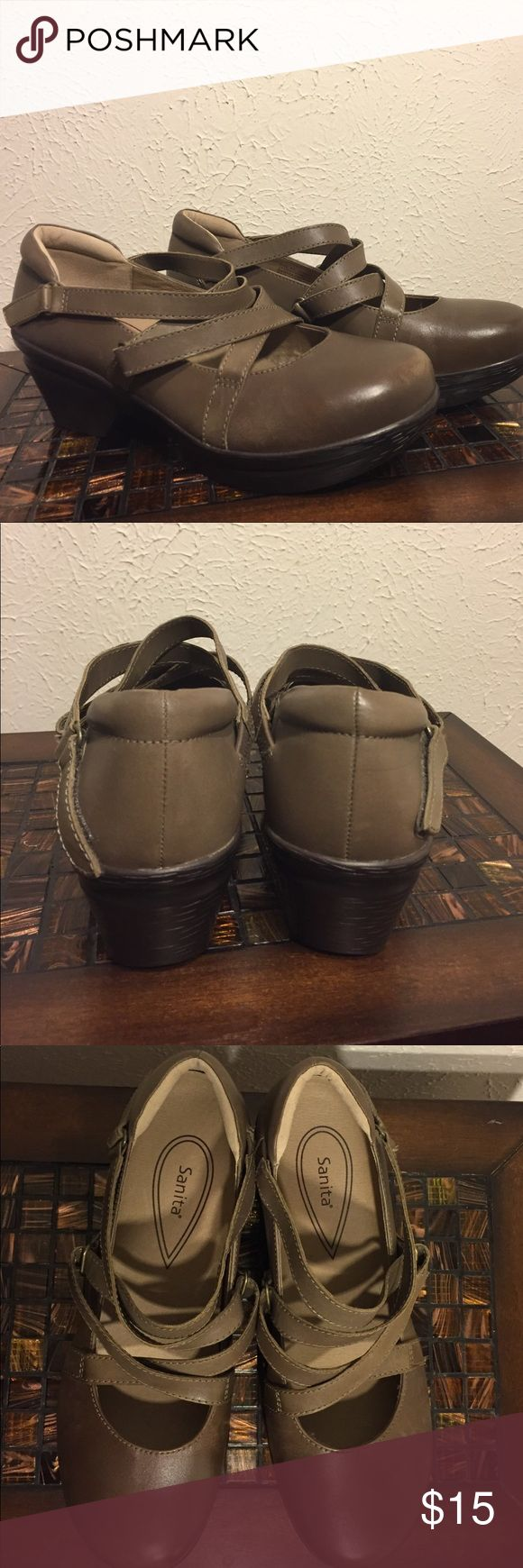 Taupe Sanita Clog like new! No toe prints! Sanita is known for having comfortable shoes! These are barely worn as they have no real wear on bottoms and have no toe prints. Some defect on right toe of shoe. Polish could fix it! Sanita Shoes Mules & Clogs
