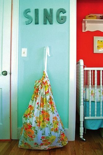 A Bright & Beautiful Bedroom for 2 Brothers & a Baby Sister | The Stir I love the word Sing on the wall...