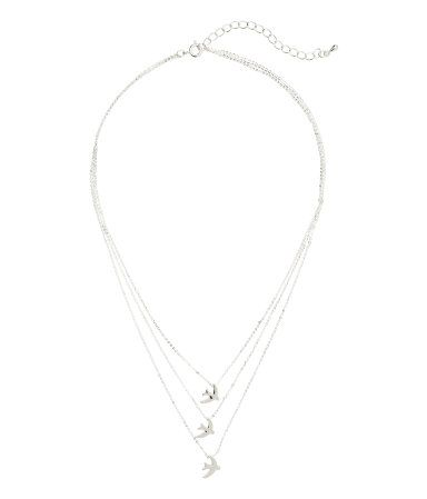 Silver-colored. Three-strand, narrow metal chain necklace with pendants. Adjustable length, 15 - 17 1/4 in.