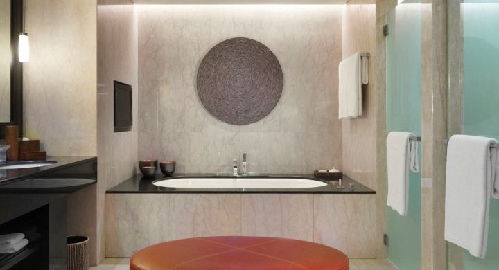 Spacious marble bathroom with selection of luxury bathroom amenities provided