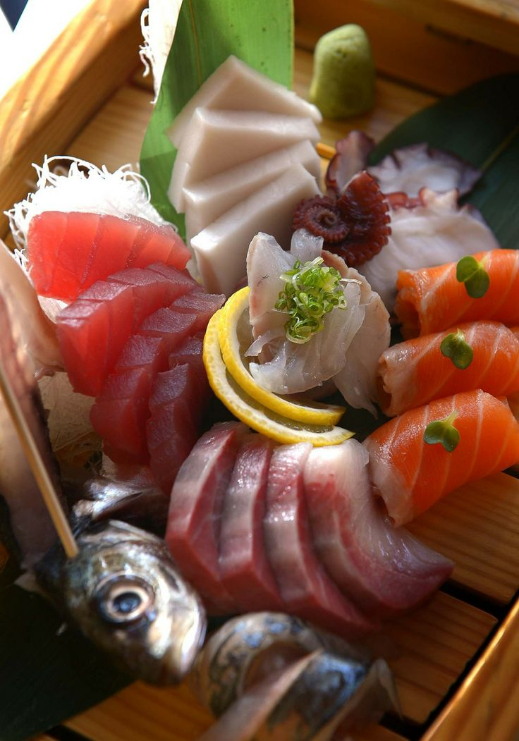 Kobe Japanese Restaurant's sashimi boat with salmon, snapper, yellowtail, tuna, escolar, mackerel and octopus. (Leah Hogsten  |  The Salt Lake Tribune)