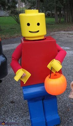 Megan: Nine year old Cameron is wearing a Lego Man costume made by his Nana. It is made from cardboard, duct tape, and foam. He loves his legos.