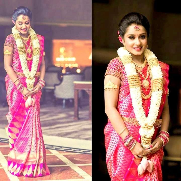 Traditional Southern Indian bride wearing bridal silk saree, jewellery and hairstyle. #IndianBridalMakeup #IndianBridalFashion Braid with fresh flowers. Flower garland.Tamil bride. Telugu bride. Kannada bride. Hindu bride. Malayalee bride