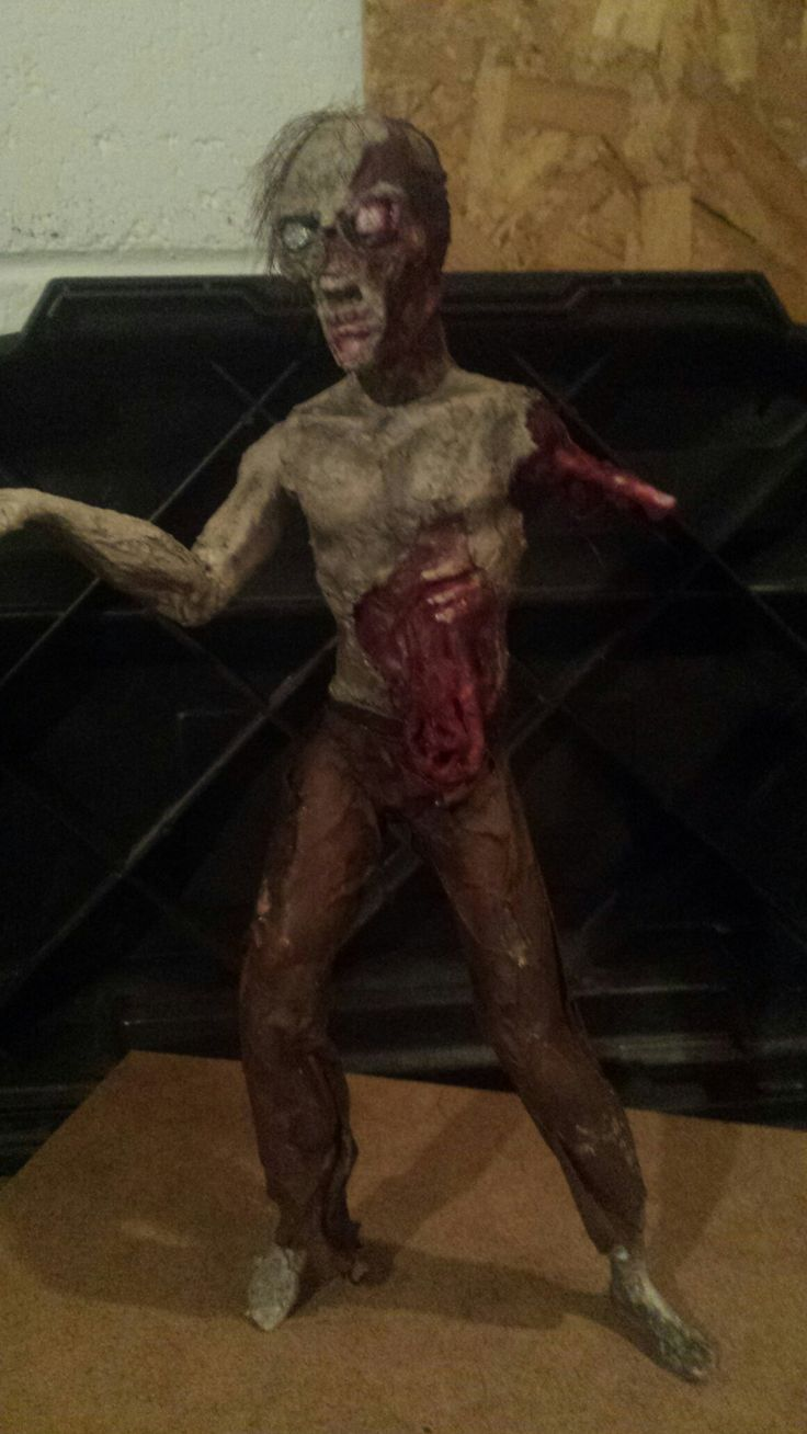 zombie made from Ken doll by Mark Mcgrath
