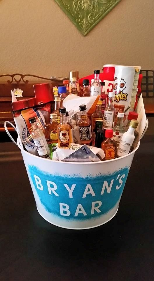 21 year old bucket for my son Bryan  20 mini alcohol bottles and one large alcohol bottle. Popcorn, beef jerky, pringles, kitchen towels, gift card to Publix, etc. all his favorite things.
