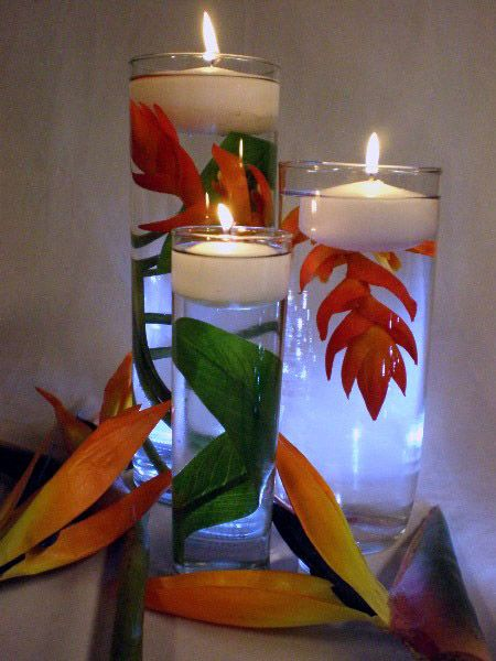 DIY How to Make a Floating Candle Centerpiece - i've seen these with glass marbles in the bottom as well and really liked them